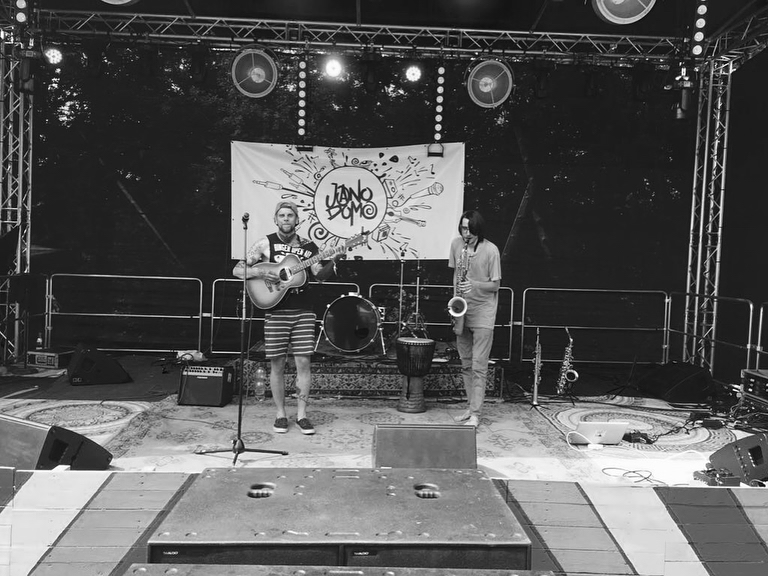 Jano Domo performing on Stage with Hans From Space Stage Banner artwork in background, Ackerkult 2018